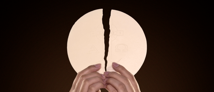 Hands holding the Eucharist